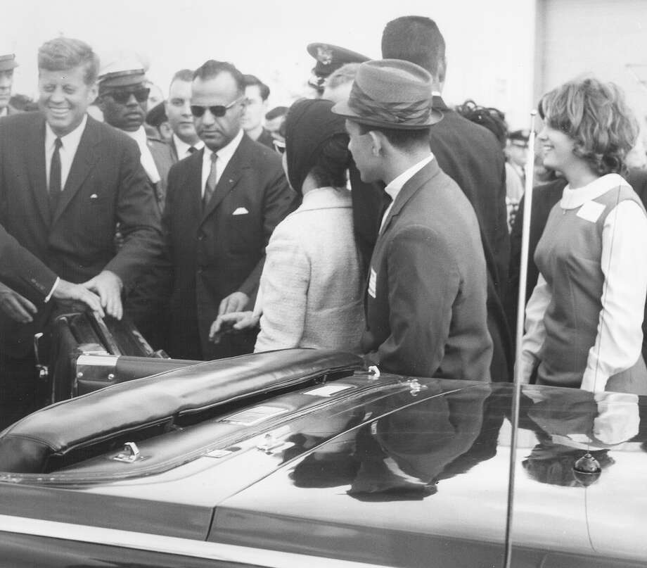 President John F. Kennedy is seen before getting into his motorcade car in San Antonio on Nov. 21, 1963, the day before he was assassinated in Dallas. Photo: San Antonio Express-News File Photo