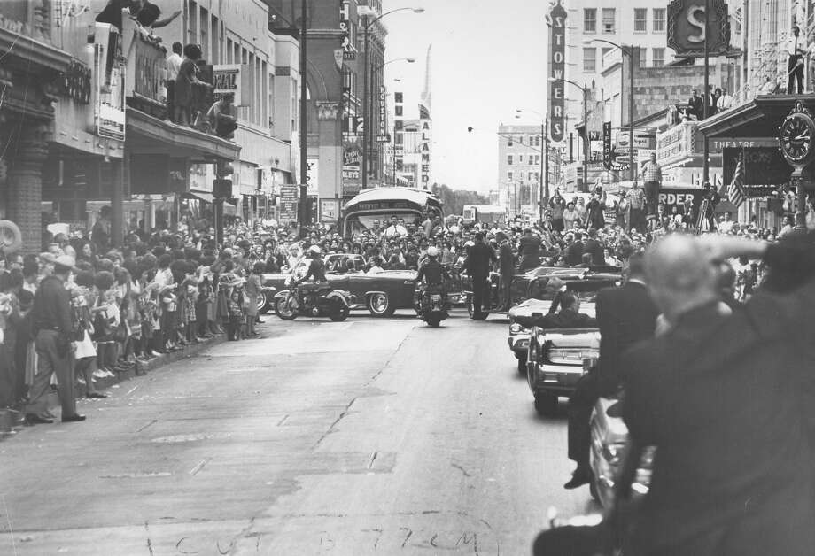 President John F. Kennedy's motorcade cruises through downtown San Antonio on Nov. 21, 1963, the day before he was assassinated in Dallas. Photo: San Antonio Express-News File Photo