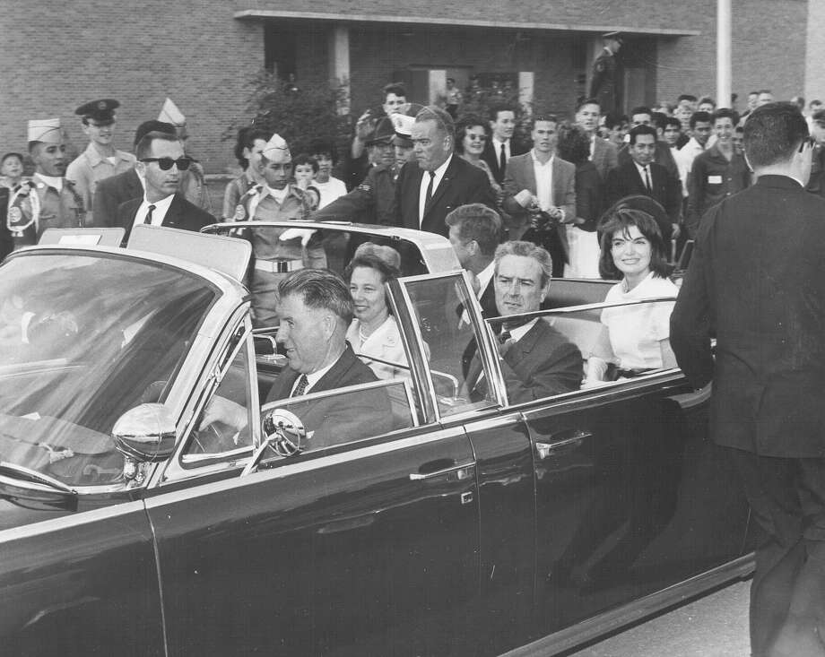 Texas Gov. John B. Connally Jr. with his wife Nellie, President John F. Kennedy and First Lady Jacqueline Kennedy are seen in their motorcade car in San Antonio on Nov. 21, 1963, one day before Kennedy's assassination in Dallas. Photo: San Antonio Express-News File Photo