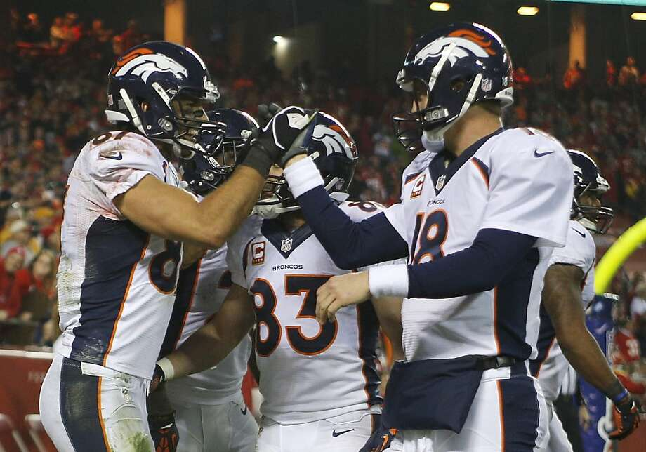 Denver Broncos wide receiver Eric Decker (87) celebrates a touchdown with quarterback Peyton Manning (18) during the second half of an NFL football game against the Kansas City Chiefs, Sunday, Dec. 1, 2013, in Kansas City, Mo. (AP Photo/Ed Zurga) Photo: Ed Zurga, Associated Press
