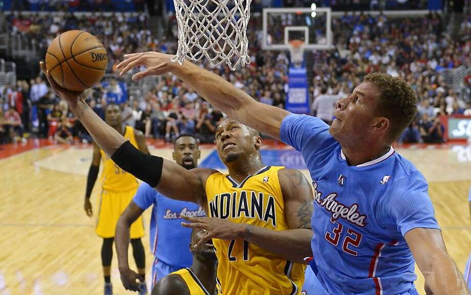 Indiana's David West (24 points) puts up a shot against the Clippers' forward Blake Griffin. Photo: Mark J. Terrill, Associated Press