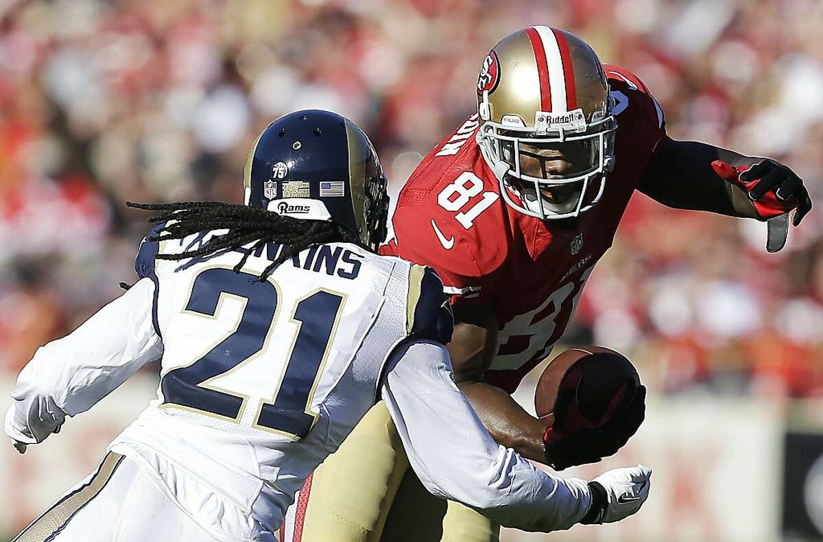 San Francisco 49ers wide receiver Anquan Boldin (81) runs against St. Louis Rams cornerback Janoris Jenkins (21) during the second quarter of an NFL football game in San Francisco, Sunday, Dec. 1, 2013. The 49ers won 23-13. (AP Photo/Tony Avelar)