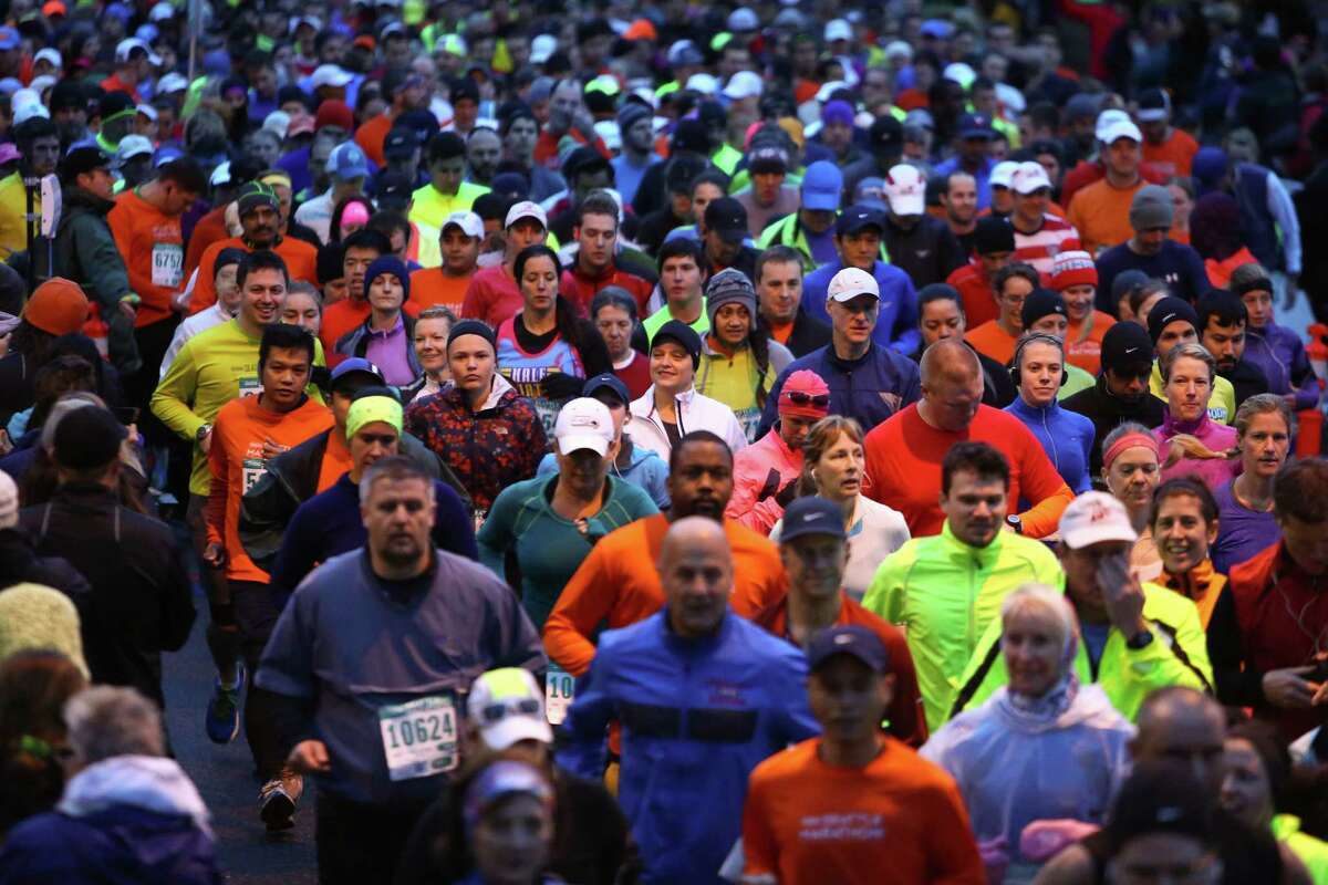 Runners depart form the early morning start of the Seattle Marathon on Sunday, Dec. 1, 2013 in downtown Seattle.