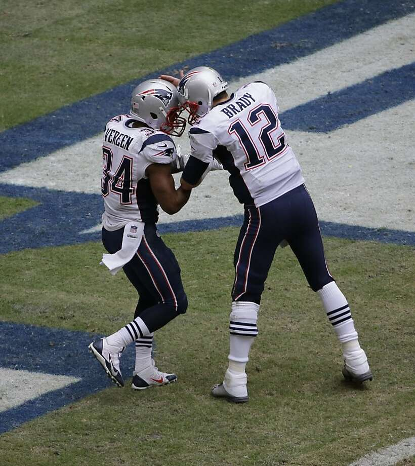 New England's Tom Brady celebrates with Shane Vereen after they connected for a touchdown during the third quarter. Photo: David J. Phillip, Associated Press