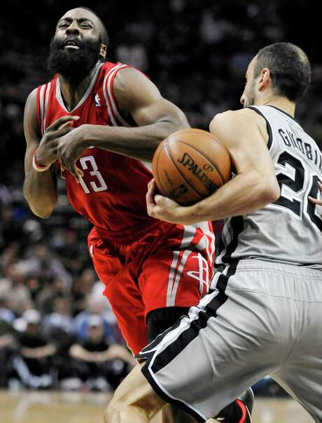 James Harden, left, takes a hit from the Spurs' Manu Ginobili during Saturday's game, in which Harden showed he's regaining his health with a 31-point outburst. Photo: Darren Abate, FRE / FR115 AP