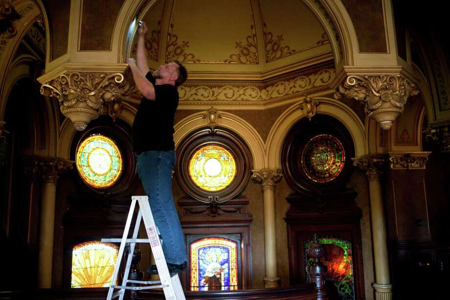 Jhonny Langer is a Galveston conservationist and restorer, whose goal is to determine the type of paint and color first applied in a given structure, thereby allowing historic restorationists to return the building to its original appearance. Photo: Marie D. De Jesus, Staff / © 2013 Houston Chronicle