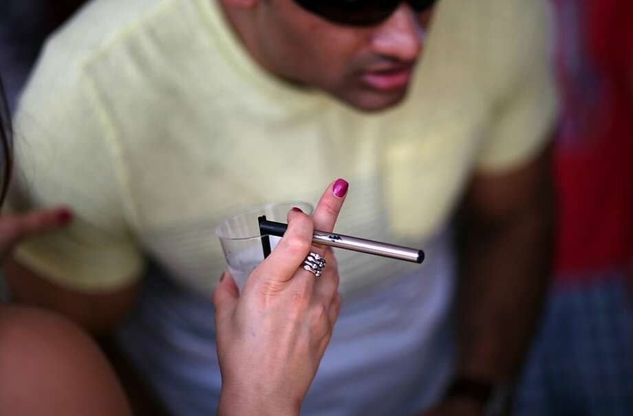 E-cigarettes appear to be a new route to nicotine addiction and heavier use of conventional cigarettes, a UCSF study in South Korea has found. Photo: Yana Paskova, New York Times