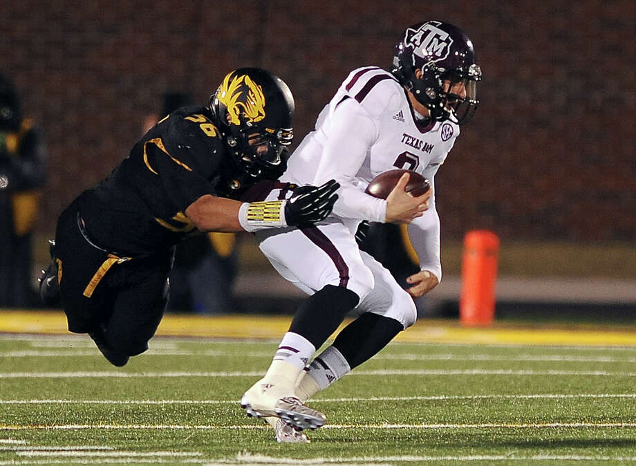 One explanation for the problems A&M's offense has had in its last two games is that Johnny Manziel, right, has had to deal with more pressure from the likes of Missouri's Shane Ray due to an offensive line that isn't up to 2012 standards. Photo: L.G. Patterson, FRE / FR23535 AP
