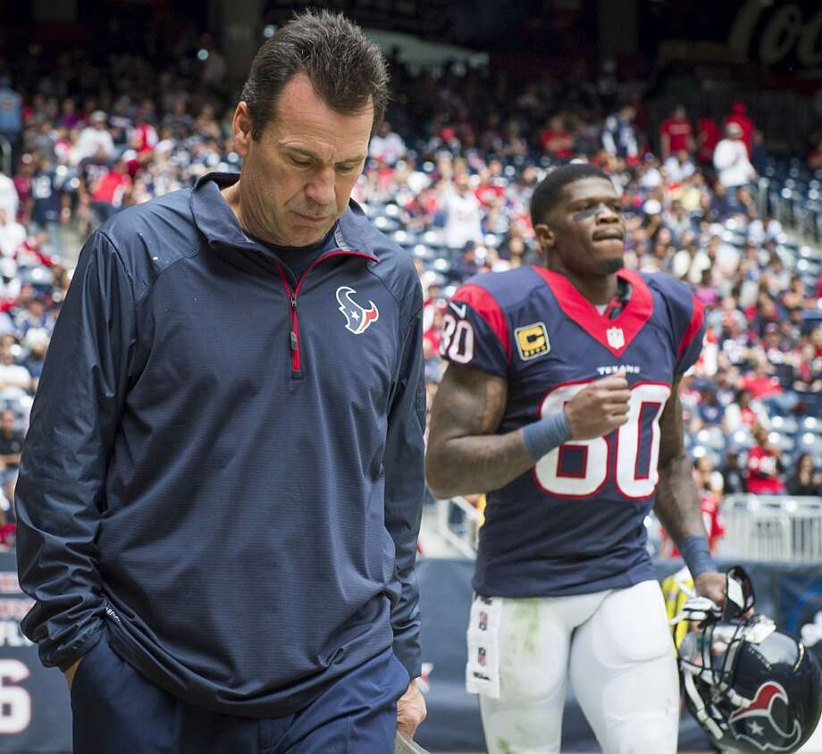 Texans head coach Gary Kubiak and wide receiver Andre Johnson, heading onto the field at NRG agains the Patriots, are both on the Texas Sports Hall of Fame ballot. Photo: Smiley N. Pool, Houston Chronicle