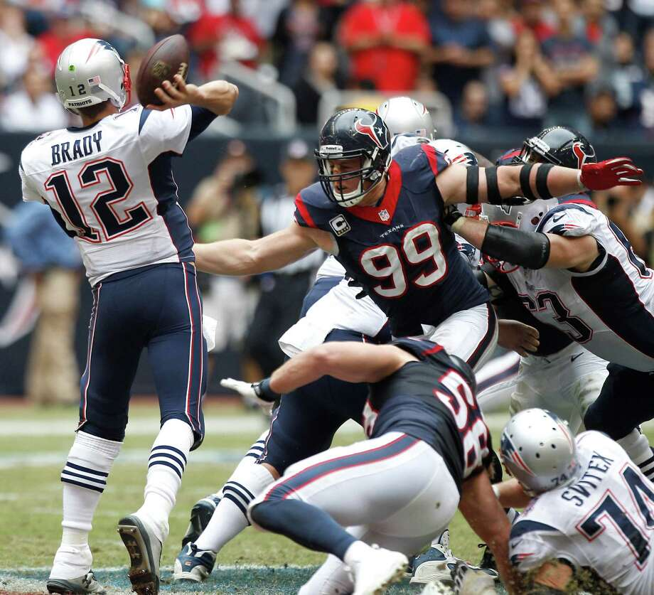 Though not for lack of trying, J.J. Watt and his fellow Texans scored just one sack of Patriots quarterback Tom Brady. The spot-free QB built on his trend of guiding his offense to second-half comebacks. Photo: Brett Coomer, Staff / © 2013  Houston Chronicle