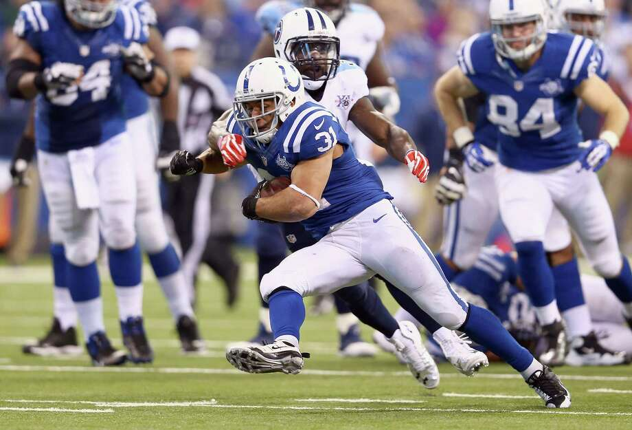 Colts running back Donald Brown (31) puts a move on Titans safety Bernard Pollard. Photo: Andy Lyons, Staff / 2013 Getty Images