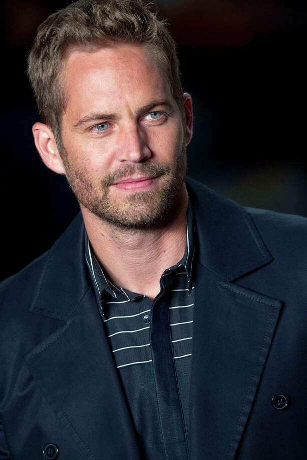 Paul Walker, age 40The 'Fast and Furious' actor died on November 30, 2013 when the speeding car he was riding in crashed into a tree and a light pole and burst into flames. Photo: Andre Penner, STR / AP