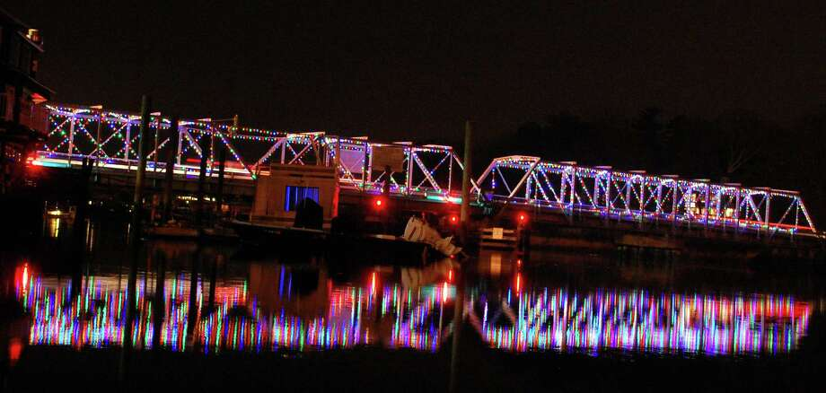 The Bridge Street bridge -- formally, the William F. Cribari Memorial Bridge spanning the Saugatuck River -- is awash in lights for the holiday. Photo: Jarret Liotta / Westport News contributed
