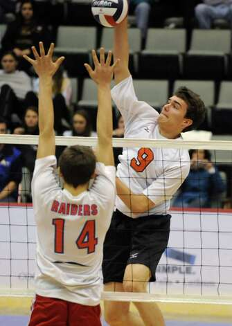 John Sica of Bethlehem, right, hits the ball past Josh Holm of Fairport during a state semifinals volleyball match on Friday, Nov. 15, 2013 in Glens Falls, N.Y.  (Lori Van Buren / Times Union) Photo: Lori Van Buren / 00024609A