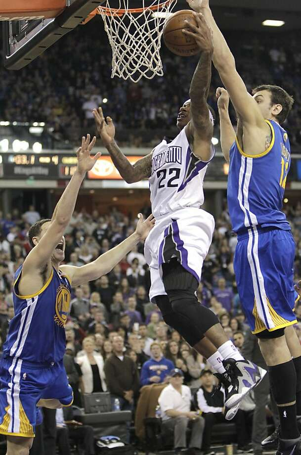 Warriors center Andrew Bogut soars to block Isaiah Thomas' layup in the closing seconds to seal the victory over the Kings. Photo: Rich Pedroncelli, Associated Press
