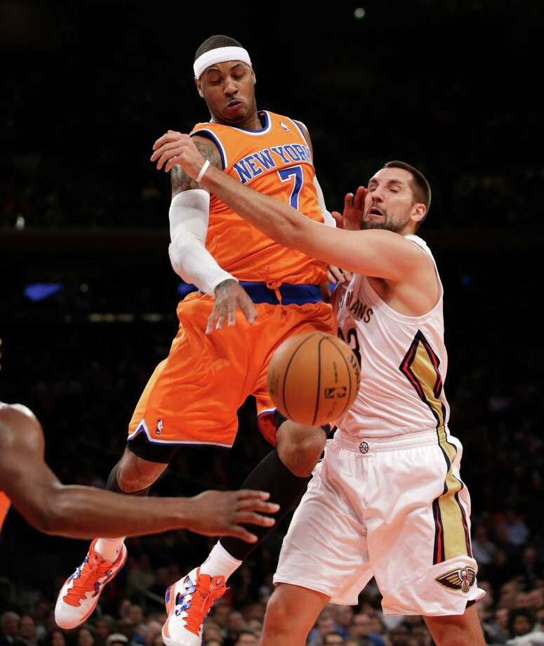 New York Knicks forward Carmelo Anthony (7) knocks the ball from the grasp of New Orleans Pelicans forward Ryan Anderson (33) in the first half of their NBA basketball game at Madison Square Garden in New York, Sunday, Dec. 1, 2013.  (AP Photo/Kathy Willens) ORG XMIT: MSG102 Photo: Kathy Willens / AP