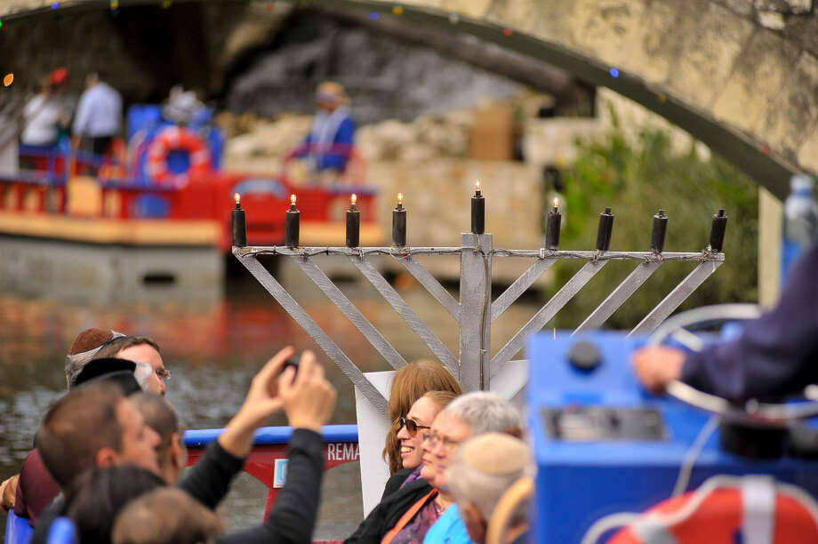 Riverboat rides were part of Chanukah on the River, organized by the Chabad Center for Jewish Life & Learning.  Photo: Robin Jerstadt, For The Express-News