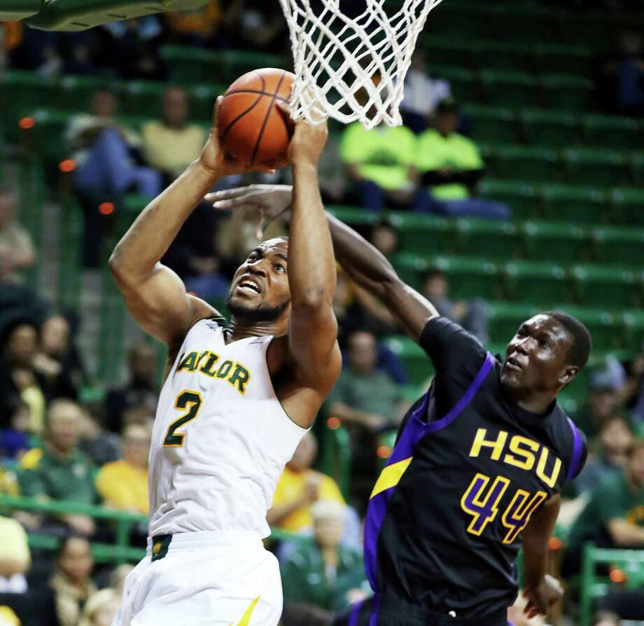 Baylor's Rico Gathers maneuvers to the basket under pressure in a lopsided win over Hardin-Simmons. Photo: Rod Aydelotte, MBO / The Waco Tribune-Herald