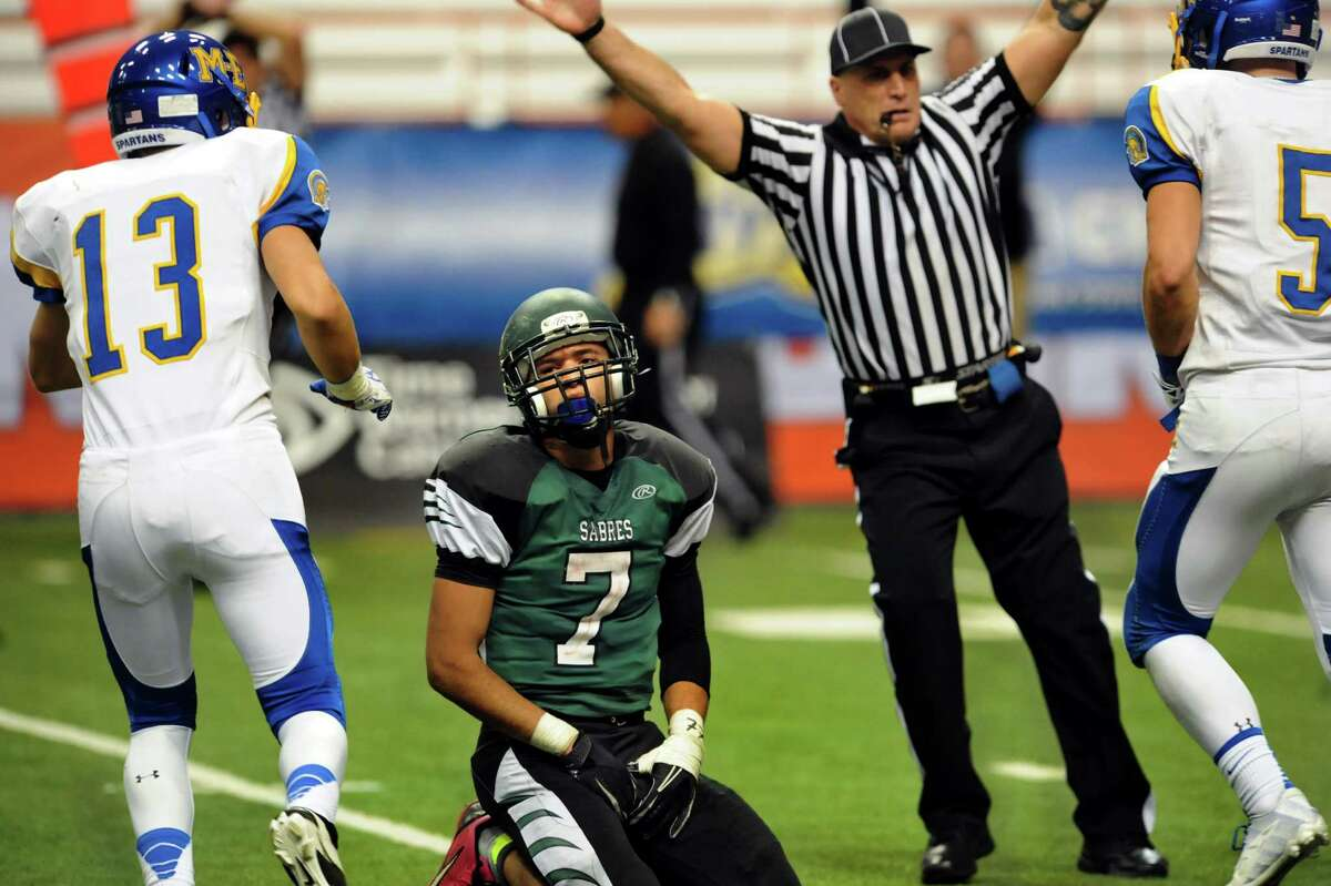 Schalmont's Trevon Perez-Tucker, center, reacts after Maine-Endwell intercepts a pass intended for him in the final moments of their Class B state football final on Sunday, Dec. 1, 2013, at the Carrier Dome in Syracuse, N.Y. (Cindy Schultz / Times Union)