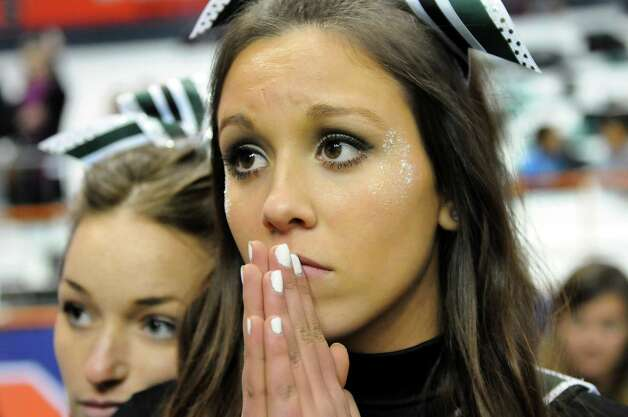 Schalmont cheerleader Sabrina Floccuzio, 16, center, reacts when Maine-Endwell scores in the final moments of the game during the Class B state football final on Sunday, Dec. 1, 2013, at the Carrier Dome in Syracuse, N.Y. Maine-Endwell wins 22-21. (Cindy Schultz / Times Union) Photo: Cindy Schultz / 00024837A