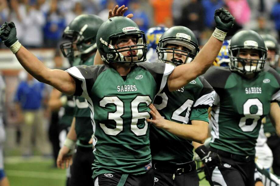 Schalmont's Nick Gallo, left, celebrates a tackle during their Class B state football final against Maine-Endwell on Sunday, Dec. 1, 2013, at the Carrier Dome in Syracuse, N.Y. (Cindy Schultz / Times Union) Photo: Cindy Schultz / 00024837A