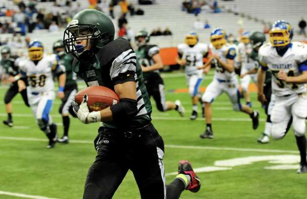 Schalmont's Trevon Perez-Tucker, center, runs  a punt return into the endzone for a touchdown during their Class B state football final against Maine-Endwell on Sunday, Dec. 1, 2013, at the Carrier Dome in Syracuse, N.Y. (Cindy Schultz / Times Union) Photo: Cindy Schultz / 00024837A
