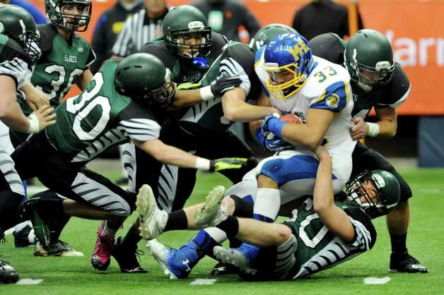 Schalmont's defense pulls down Maine-Endwell's running back Darnell Woolfolk, right, during their Class B state football final on Sunday, Dec. 1, 2013, at the Carrier Dome in Syracuse, N.Y. (Cindy Schultz / Times Union) Photo: Cindy Schultz / 00024837A