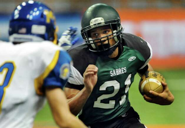 Schalmont's Devon Willis, right, carries the ball during their Class B state football final against Maine-Endwell on Sunday, Dec. 1, 2013, at the Carrier Dome in Syracuse, N.Y. (Cindy Schultz / Times Union) Photo: Cindy Schultz / 00024837A