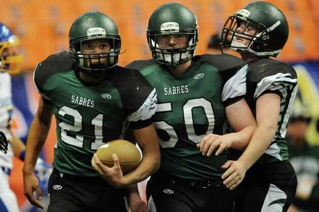 Schalmont's Devon Willis, left, scores a touchdown during their Class B state football final against Maine-Endwell on Sunday, Dec. 1, 2013, at the Carrier Dome in Syracuse, N.Y. (Cindy Schultz / Times Union) Photo: Cindy Schultz / 00024837A