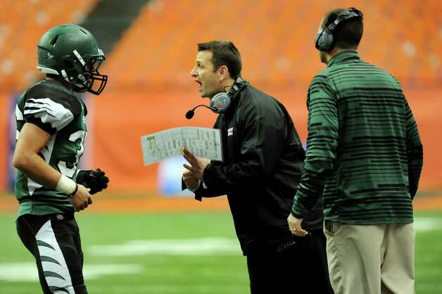 Schalmont's coach Joe Whipple, center, instructs quarterback Nick Gallo, left, during their Class B state football final against Maine-Endwell on Sunday, Dec. 1, 2013, at the Carrier Dome in Syracuse, N.Y. (Cindy Schultz / Times Union) Photo: Cindy Schultz / 00024837A