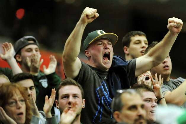 Schalmont's former quarterback Joe Paskevich, center, joins fans in  cheering on their team during the Class B state football final against Maine-Endwell on Sunday, Dec. 1, 2013, at the Carrier Dome in Syracuse, N.Y. (Cindy Schultz / Times Union) Photo: Cindy Schultz / 00024837A