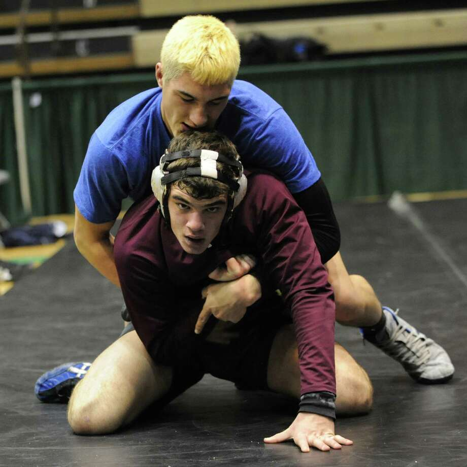 Burnt Hills junior Jacob Ashcraft, bottom,  scrimmages against Tyler Blasko of Wallkill at Hudson Valley Community College on Friday, Nov. 29, 2013 in Troy, N.Y. (Lori Van Buren / Times Union) Photo: Lori Van Buren / 00024840A