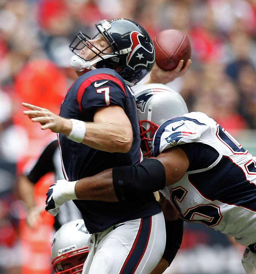 Houston Texans quarterback Case Keenum (7) is hit by New England Patriots defensive end Andre Carter (96) as he releases a pass during the second quarter at Reliant Stadium on Sunday, Dec. 1, 2013, in Houston. ( Brett Coomer / Houston Chronicle ) Photo: Brett Coomer, Staff / © 2013  Houston Chronicle