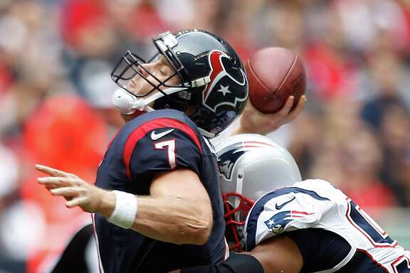 Houston Texans quarterback Case Keenum (7) is hit by New England Patriots defensive end Andre Carter (96) as he releases a pass during the second quarter at Reliant Stadium on Sunday, Dec. 1, 2013, in Houston. ( Brett Coomer / Houston Chronicle )