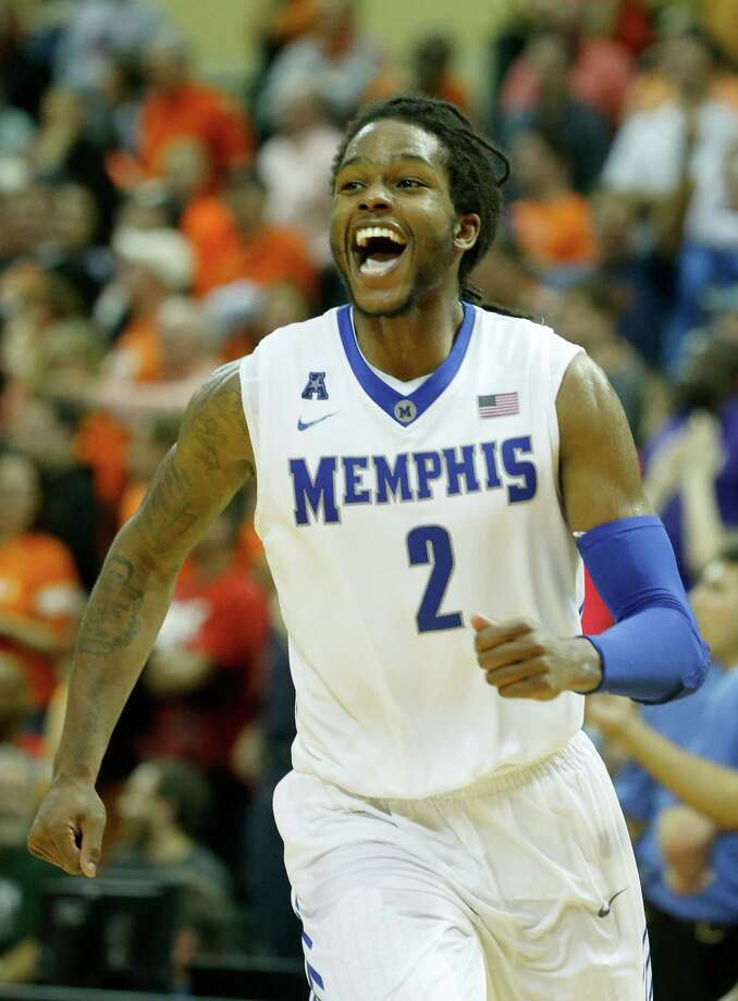 Memphis' David Pellom smiles as the No. 21 Tigers upset No. 5 Oklahoma State 73-68 in the Old Spice Classic final. Memphis held preseason All-American Marcus Smart to 12 points. Photo: Sam Greenwood / Getty Images