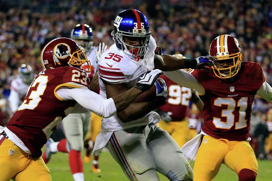LANDOVER, MD - DECEMBER 01:  Andre Brown #35 of the New York Giants runs the ball in for a touchdown in the second quarter against DeAngelo Hall #23 and Brandon Meriweather #31 of the Washington Redskins during their game at FedExField on December 1, 2013 in Landover, Maryland.  (Photo by Rob Carr/Getty Images) ORG XMIT: 184899277 Photo: Rob Carr / 2013 Getty Images