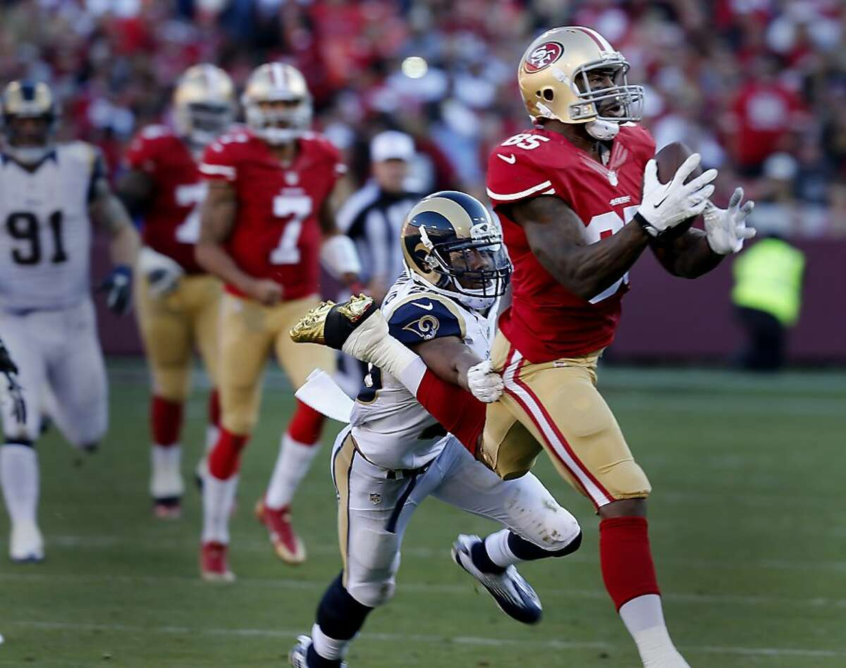 Vernon Davis (85) makes a catch for a long gain in the second half. The San Francisco 49ers defeated the St. Louis Rams 23-13 at Candlestick Park Sunday December 1, 2013.