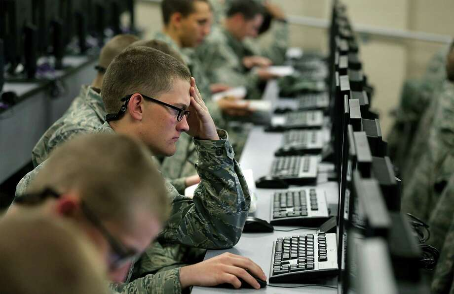 Trainees at Joint Base San Antonio-Lackland take a survey developed in the wake of the sexual-assault scandals at the base. It seeks to uncover wrongdoing and give the Air Force a better understanding of how recruits view basic training. Photo: Bob Owen / San Antonio Express-News