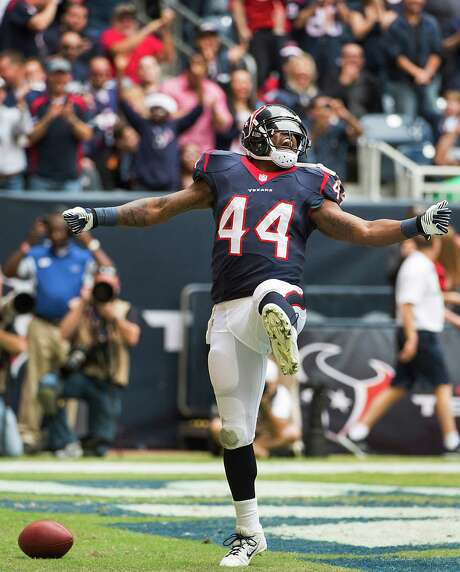 Texans running back Ben Tate celebrates after scoring on an 8-yard touchdown run in the first half Sunday against the Patriots. It was one of three rushing touchdowns for Tate in the Texans' 34-31 loss. Photo: Smiley N. Pool, Staff / © 2013  Houston Chronicle