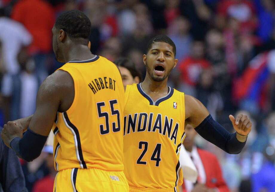 Paul George, right, and Roy Hibbert have a good time near the end of the Pacers' win over the Clippers. Photo: Mark J. Terrill, STF / AP