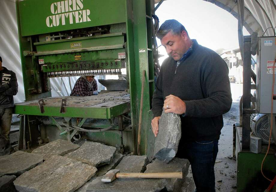 Carlo Vona Jr., the owner of Paramount Stone Co. in Stamford, shows a stone after it's been through a cutting machine on Nov. 18. Photo: Dru Nadler / Stamford Advocate
