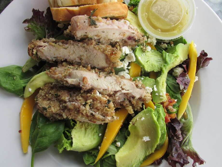 Katharine & Company's mango and avocado salad with Parmesan chicken added. Photo: Cat5