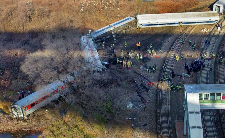 "First responders gather at the derailment of a Metro North passenger train in the Bronx borough of New York Sunday, Dec. 1, 2013  The Fire Department of New York says there are ""multiple injuries"" in the  train derailment, and 130 firefighters are on the scene. Metropolitan Transportation Authority police say the train derailed near the Spuyten Duyvil station. Photo: Craig Ruttle, AP / FR61802 AP"