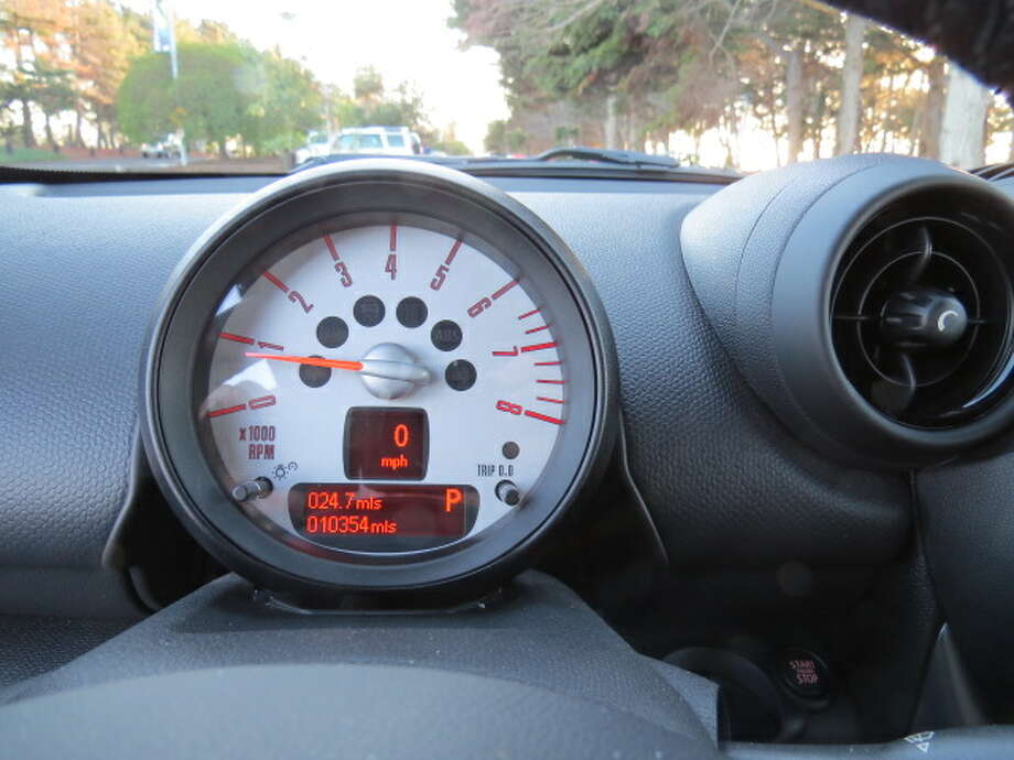The tachometer, directly in front of the driver, has a small digital speedometer. It's not easy to read while you're driving.