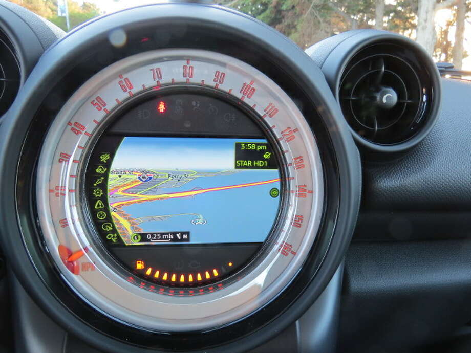 In this close-up of the center stack information screen, note the red speedometer needle going around the periphery of the instrument. Not easy to read from the driver's seat.