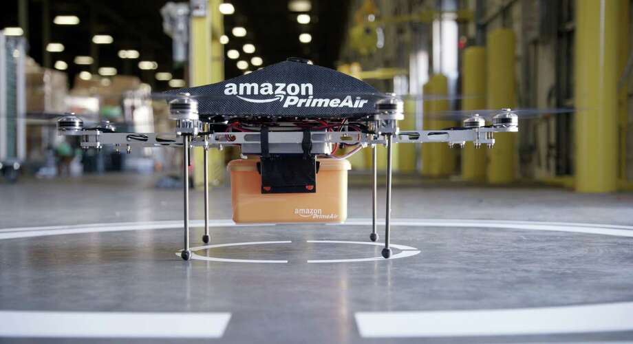 "This undated handout photo released by Amazon on December 1, 2013 shows an ""octocopter"" mini-drone that would be used to fly small packages to consumers. Amazon CEO Jeff Bezos revealed on December 1 that his company was looking to the future with plans to use mini-drones to deliver small packages. AFP PHOTO / AMAZON  --- EDITORS NOTE --- RESTRICTED TO EDITORIAL USE - MANDATORY CREDIT ""AFP PHOTO / AMAZON "" - NO MARKETING NO ADVERTISING CAMPAIGNS - DISTRIBUTED AS A SERVICE TO CLIENTSAMAZON/AFP/Getty Images ORG XMIT: MER2013120208060701 Photo: AMAZON / AFP"