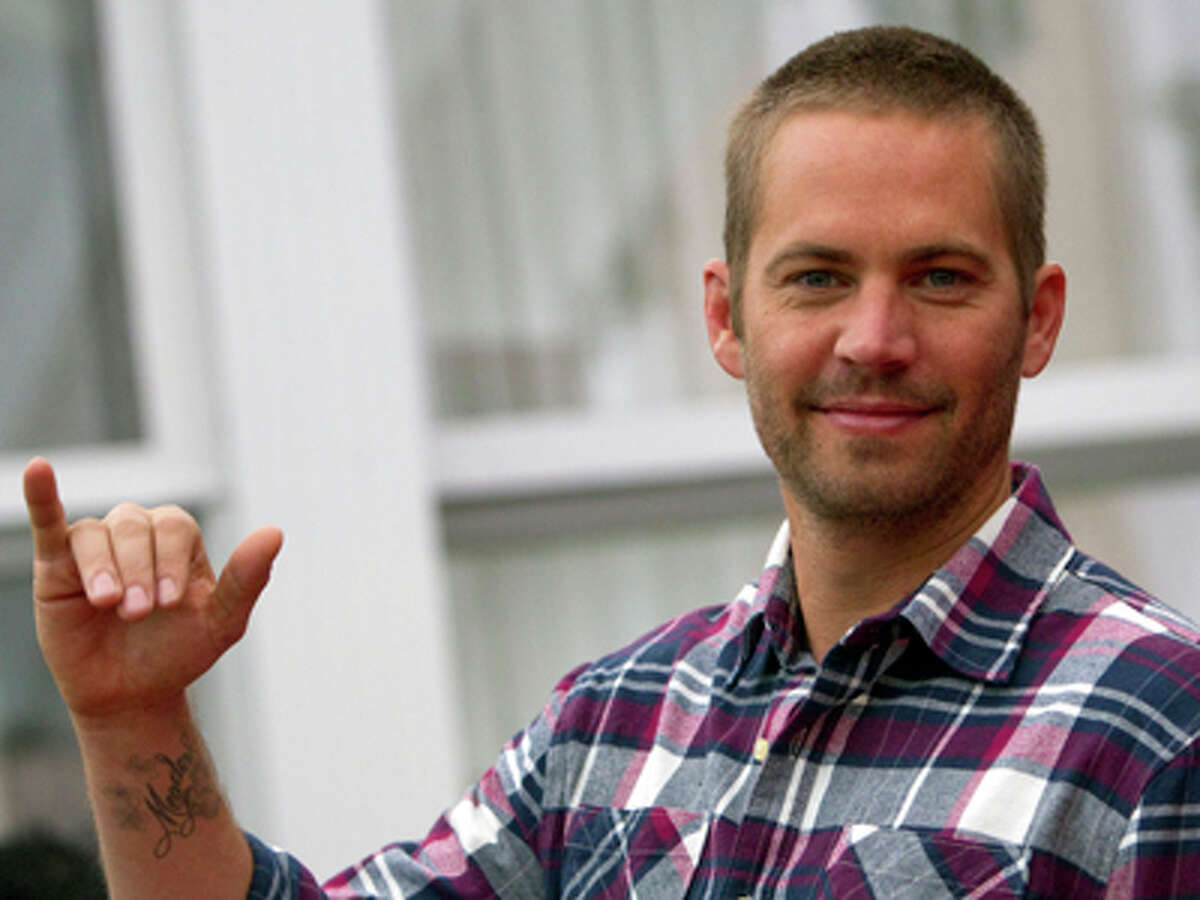 Actor Paul Walker poses during the photo call of the movie