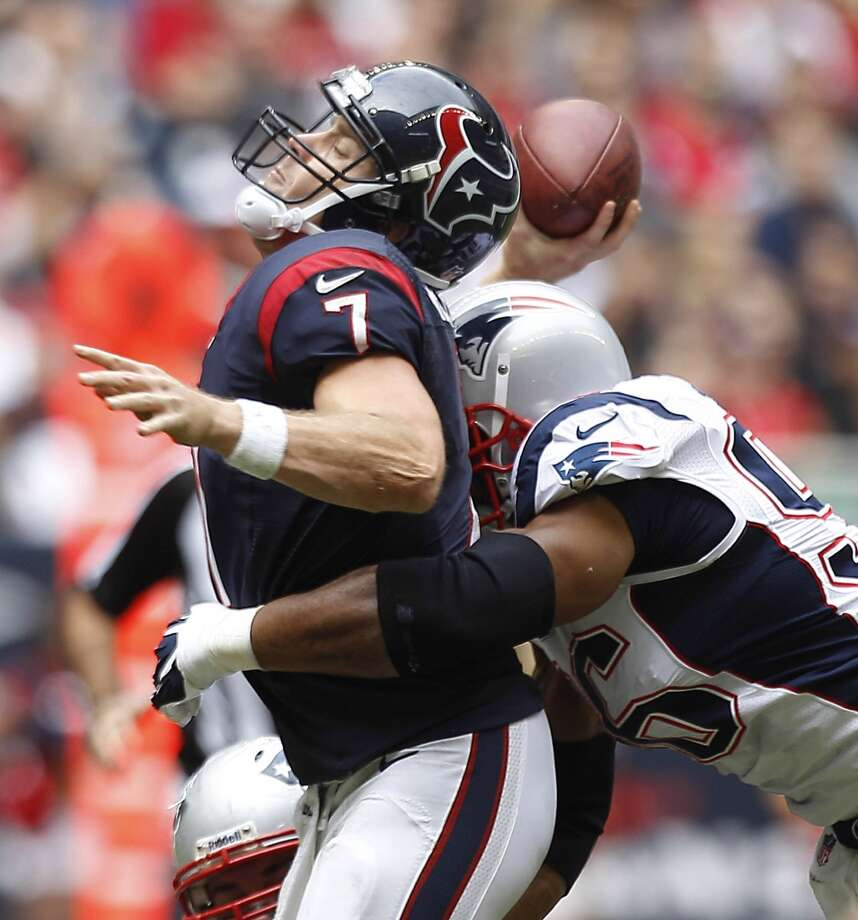 Texans quarterback Case Keenum is hit by Patriots defensive end Andre Carter as he releases a pass during the second quarter. Photo: Brett Coomer, Houston Chronicle