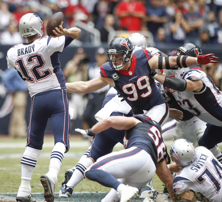 Patriots quarterback Tom Brady throws a pass over Texans defensive end J.J. Watt. Photo: Brett Coomer, Houston Chronicle