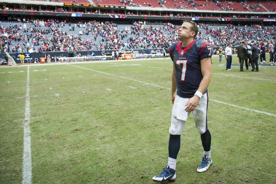 Texans quarterback Case Keenum walks off the field after the loss to the Patriots. Photo: Smiley N. Pool, Houston Chronicle